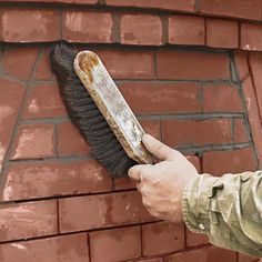 When the mortar is firm to the touch, brush diagonally across it to remove any dry mortar crumbs. (Brushing in line with the joints can pull out the fresh mortar.) Then carefully sponge mortar residue off the brick faces. For the next three days, use a tarp to protect the soft joints from the sun, wind, or hard rain, and give the wall a daily misting to keep the brick and mortar moist.