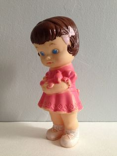 Edward Mobley rubber squeeze doll in pink dress with bear