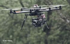 Quadcopter Aerial Photography..... CineStar 8 OctoCopter with a 3-axis camera gimbal carrying a Red Epic-X camera.