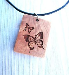 lovely wooden pendant.. pyrography butterflies?