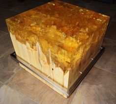 Coffee table created from resin, wood and stainless steel
