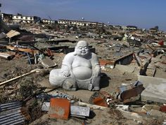 *A statue of Hotei Buddha sits in the debris in the tsunami-destroyed town of Sendai, Japan.  (Photo: AP via the New York Post)