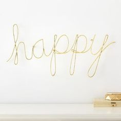 MayBaby Wire Happy Wall Décor:  Inspire your space with gold artwork that makes your walls shine. Designed with DIY internet-sensation Meg DeAngelis, this fresh new MayBaby collection captures her bright style.
