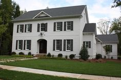 This inspiration exterior features painted brick in Eider White and shutters in Black Fox for the ideal contrast. White Exterior Paint, White Exterior Houses, Exterior Paint Colors For House, White Houses, Exterior Colors, Exterior Homes, White Paint Colors, White Paints, Painted Brick Exteriors