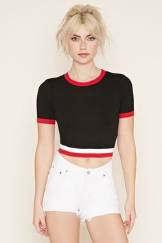 A knit crop top varsity-striped trim along the hem, a ribbed trim on the round neckline and short sleeves.