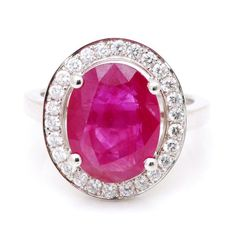 A beautiful Tanzanian Ruby. The stone is 5.06ct oval and is hand mounted in 18ct white gold with stunning GVS diamonds in the outer row.