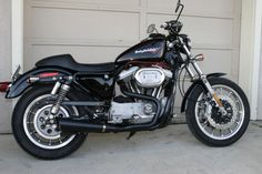 I have a masochistic want to build a Sportster as an around town bike, something like this 2002 XL1200S... note the details like the Brembo brakes...