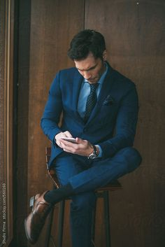 Businessman using mobile phone in office. by dijanato | Stocksy United