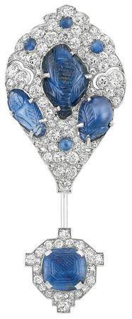 Art Deco Platinum, Carved Sapphire and Diamond Jabot, Cartier. Circa 1925.