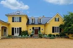 yellow house red door black roof - Google Search