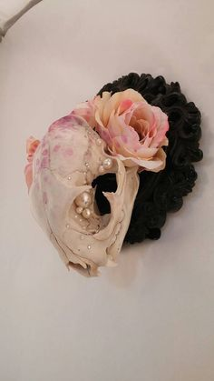 This is Tess flower crowned painted bobcat skull by HAIAbyNikki