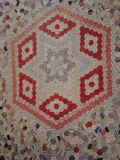 "Star Centred Hexagon by H.e.l.e.n., via Flickr.  This is an 1890s English quilt made with 1/2"" hexagons. The centre has been set out in a star design by using the same fabrics to create the design where the rest of the quilt has been made by using all different fabrics for the hexagons"