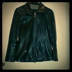 GUESS GENUINE LEATHER JACKET Black genuine leather jacket by Guess. Womens size small.Jacket has recently been dry cleaned it just needs to be conditioned. Only one tiny flaw which is a tiny spot on the right arm. I tried to illustrate this in the forth picture but it is hardly noticeable as you may see. Besides that it has minimal fading which should be restored upon conditoning. This is a very warm jacket from a smoke free home. Guess Jackets & Coats