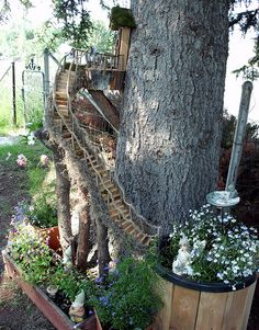 This is a Fairy Garden that my Hubby and I built. :) July 2012 Then we redid some of it in 2013. You will be able to see some of the changes we made. ;)