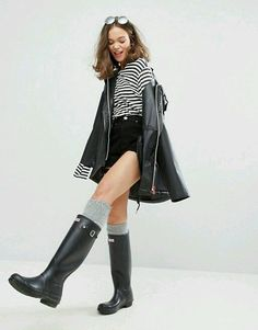 Black rubber wellies with gray socks and raincoat