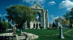 The St. Boniface Cathedral Cemetary in Winnipeg, Manitoba, Canada  - Louis Riel is buried here, along with many other pioneers   - during daylight hours people report feelings of unease and being watched  - after the sun sets, it comes alive with apparitions appearing through the ruins, whispers and cries are heard, unexplained noises, light anomalies, a spectral image of a burning cathedral is often seen here and then disappears