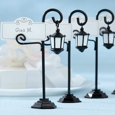 Take your guests back with these vintage street lamp place card holders with coordinating place cards!