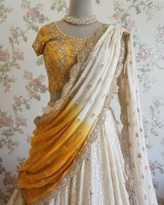 Lehenga Choli are the most preferred Indian Ethnic Wear for Woman. This Ivory and Mustard Yellow Lucknowi Lehenga Choli can uplift your style. Lehenga Choli Latest, Half Saree Lehenga, Saree Dress, Anarkali Gown, Lehenga Blouse, Designer Bridal Lehenga, Indian Bridal Lehenga, Rajasthani Lehenga, Bridal Sarees