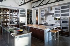 Features include vaulted ceilings, brick walls, heated concrete floors, skylights throughout, and a spectacular commercial-grade kitchen.