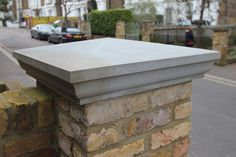 Grey Yorkstone Pier Caps compliment traditional London stock bricks perfectly. This pier cap has a Victorian edge profile and four times weathered top for a classic look.