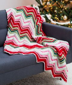 Ripples of Joy Throw Free Crochet Pattern in Red Heart With Love yarn - Playful with a joyful attitude, this crocheted throw is perfect for the holiday season, but can be used really any time of the year. We've used six colors and added post stitches for added texture.