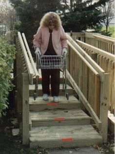 ARTICLE:  Long-tread, Low-riser steps instead of ramps - For many people with mobility impairments, long-tread, low-riser steps can be easier and safer to use when compared to a 1:12 slope ramp. The large level step tread allows easy walker use, and the risers short height makes stepping up and down easier than standard steps. Balance is easier to maintain on the level steps than on a sloped surface; the steps requires less space than a ramp and are less expensive.