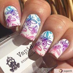Butterfly stamping using @uberchicbeauty 9-02, @mundodeunas Orchid, Turquoise and Purple over @vapidlacquer Optimist.