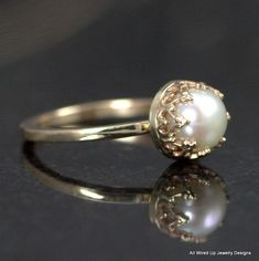 This is so simple and lovely!! Especially with the yellow gold (much nicer than the silver one I've pinned).  (Custom Made 14k Gold Pearl Ring - Pearl Engagement Ring - Sizes 3 - 12)