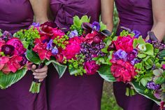 Love purple maids with bouquets in a variety of purples/blues/fuschias/greens. (Emily Herzig floral)
