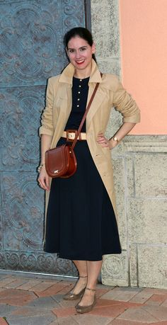 Khaki Trench Coat, Navy Blue Wrap Skirt and Henley Sweater, Bally Cross-Body Bag, with Ralph Lauren Belt, and Frye Ankle-TIe Flat Shoes in Gold and Lenora Dame Charm Bracelet. Nancy Drew inspired outfit for a rainy day!
