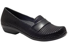 It's black and polka-dotted, but you can get just plain black and other colors too. Dansko Oksana Black Polka Dot