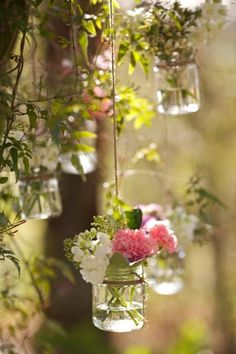 Hanging jars of flowers.- would be great touch of color to a fall wedding or party.