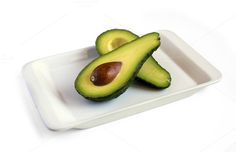 Check out Fresh avocado on plate by Grounder on Creative Market