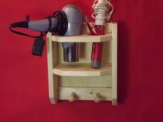 Hair dryer holder / organizer / rack / caddie / blow dryer organizer holder. $19.95, via Etsy.