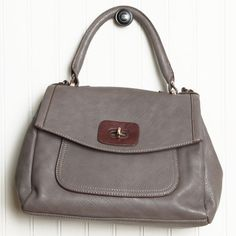 "Sandra Convertible Shoulder Purse By Melie Bianco 98.99 at shopruche.com. Casually sophisticated, this structured, gray leatherette purse by Melie Bianco is perfected with contrasting brown accents, golden hardware, and large interior compartment., ,  All man-made materials,  12.5"" L x 9.5"" H x 5.5"" W ,  19"" strap drop, Turn key closure ,  Interior zipper compartment includes small..."