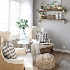 You have to see this #farmhouse living room decor idea with rustic shelves with corbels. Love it! #RusticDecor #HomeDecorIdeas