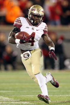 Dalvin Cook #4 of the Florida State Seminoles runs the ball in the second half against the Louisville Cardinals during their game at Papa John's Cardinal Stadium on October 30, 2014 in Louisville, Kentucky.