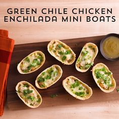 Enchiladas for a crowd without the rolling?! These delicious Green Chile Chicken Enchilada Mini Boats are the perfect combo of great enchilada flavor and easy to eat party food for any game day table.