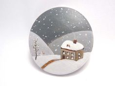 Wooden brooch, hand painted miniature snowy scenery with house, tree and tiny snowman, original miniature wearable art. €14.00, via Etsy.