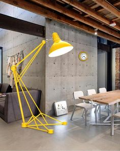 This big standing reading arc lamp Diana with bright yellow finish can bring contemporary touch and colorful inviting space to your house
