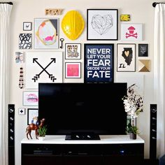 Help your TV blend in a little more by surrounding it with a gallery wall!