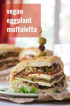 This vegan muffaletta sandwich is packed with spicy marinated eggplant, roasted red pepper slices, and zippy olive salad! A delicious make-ahead vegan sandwich that gets better with time. Perfect for lunch, dinner, game-day and picnics! Eggplant Sandwich, Vegan Eggplant, Vegan Lunches, Vegan Comfort Food, Olive Salad, Vegan Dishes, Vegetarian Recipes, Vegetarian Italian, Raw Recipes