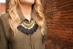 Olive green with faux leather. Add a tassel necklace for some extra fun!