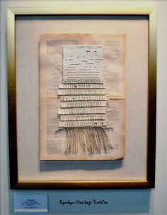 """""""Obsolete"""", Cheryl Silverblatt's woven piece mounted on a page from a book."""