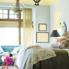 Blue bedroom with yellow accents throughout and yellow ceiling....a non-standard design.  Hmmm