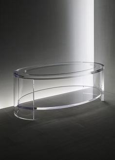 ACRYLIC - Eclipse oval coffee table in acrylic and glass with lower shelf