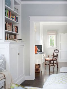 An office open to the master bedroom is another space designed for the adults of the house. A desk flanked by built-in cabinets provides storage for household records and other important papers.