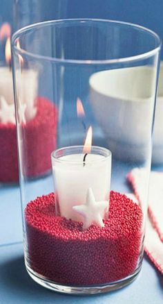 Easy Table Decor for 4th of July....except I would change the candle color to dark blue to incorporate a more patriotic theme!