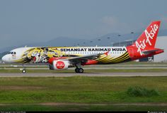AirAsia (MY) Airbus A320-216 9M-AFI aircraft, painted in ''Semangat Harimau Muda'' special colours Aug. 2012, skating at Malaysia Kuala Lumpur International Airport. 09/12/2014. (Semangat Harimau Muda=Malaysian National Fotball Team).