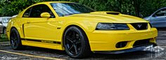 Yellow 2003 Ford Mustang GT..this car is exactly what i want..bright yellow...black wheels...black interior...chin spoiler...spoiler...GT